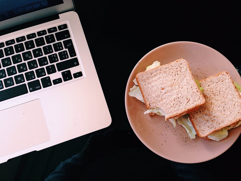 sandwich next to laptop