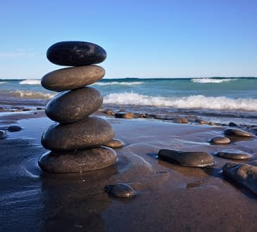 image balanced rocks on a beach